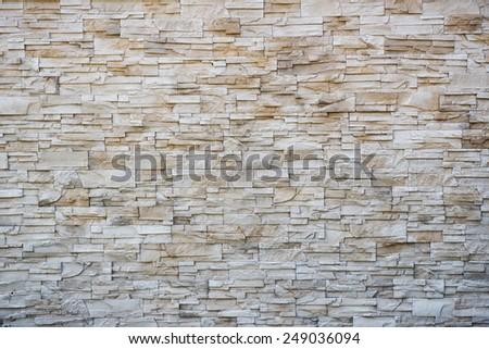 irregular, beige, brick background. big image - stock photo