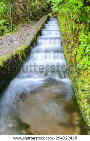 Irrigation canal  along Twenty-five Fountains Levada hiking trail, Madeira (Portugal) - stock photo
