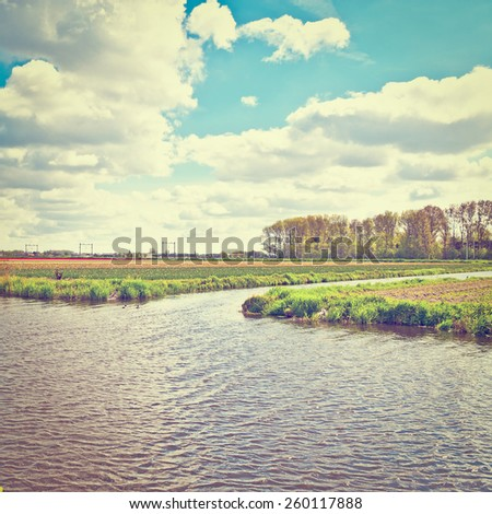 Irrigation Canal between the Fields of Tulips, Netherlands, Instagram Effect - stock photo