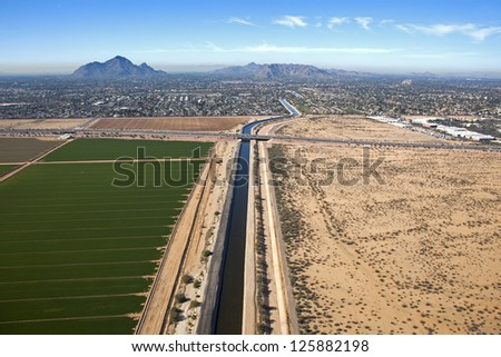 Irrigation canal cutting through Reservation and Scottsdale, Arizona - stock photo