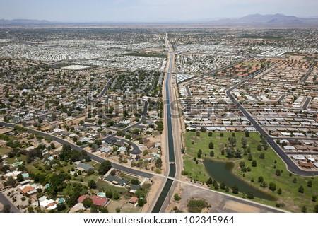 Irrigation canal cutting through suburban Mesa, Arizona - stock photo