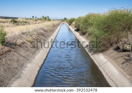Irrigation ditch in the plain of the River Esla, in Leon Province, Spain. - stock photo