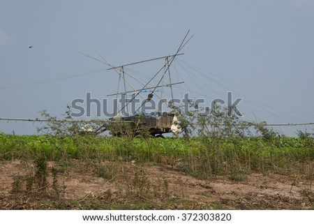 Irrigation equipment to pump water to fields from the river, Kompong Kleang floating fishing village,  Cambodia