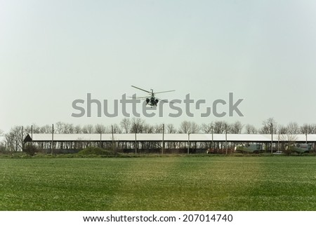 Irrigation of fields using helicopter