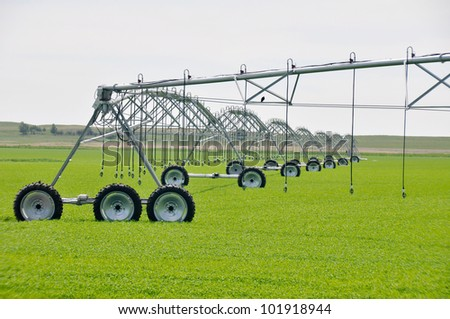 Irrigation sprinklers in a farm field (Canada) - stock photo