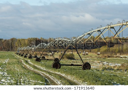 Irrigation System in a farmers field - stock photo