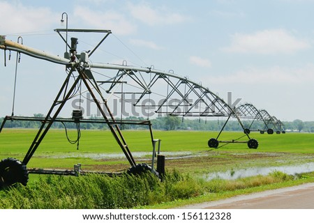 Irrigation system on field  - stock photo