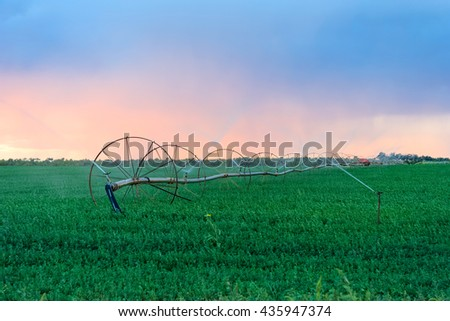 Irrigation Wheels at farmlands - stock photo