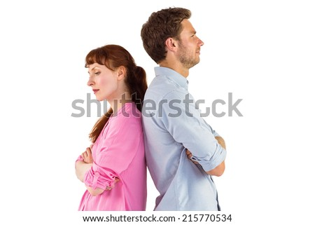 Irritated couple ignoring each other on white background