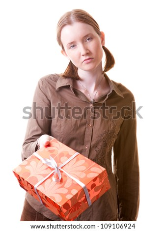 Irritated girl giving present box to somebody - stock photo