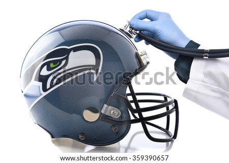 IRVINE, CA - JANUARY 6, 2015: Seattle Seahawks Football Helmet with Stethoscope. Sports Concussion concept, an ongoing problem in the NFL.