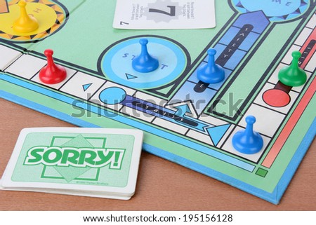 IRVINE, CA - MAY 19, 2014: Sorry! board game closeup. Sorry! is a game based on the ancient Cross and Circle game Pachisi. The game is made by Parker Brothers a Division of Hasbro. - stock photo