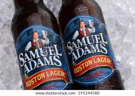 IRVINE, CA - MAY 25, 2014: Two bottles of Samuel Adams Boston Lager on a bed of ice. Brewed by the Boston Beer Company one of the largest American-owned beermakers.