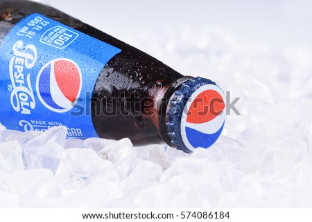 IRVINE, CALIFORNIA - FEBRUARY 7, 2017: Pepsi-Cola Bottle on ice. Pepsi is one of the leading producers of soda and soft drinks in the USA.