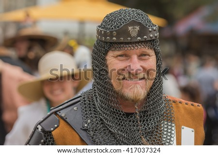 Irwindale, CA - USA - May 07, 2016: an with medieval knight costume during The 54th Annual Renaissance Pleasure Faire.