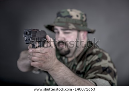is a soldier wearing his uniform and gun
