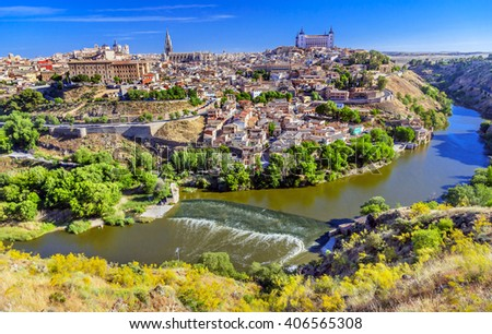 is Alcazar Fortress Medieval City Tagus River Toledo Spain.  Toledo Alcazar built in the 1500s, Unesco historical site; Tagus is longest river in Spain. - stock photo