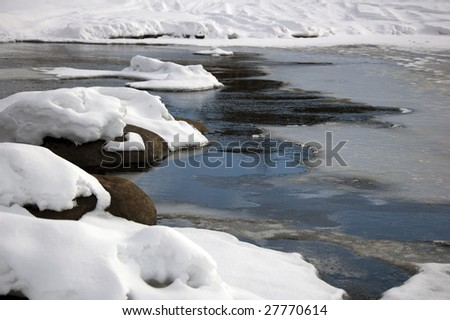 is begin to melt on the rivers - stock photo