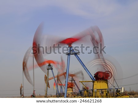 Is operation of the pumping unit in oilfield site, close-up