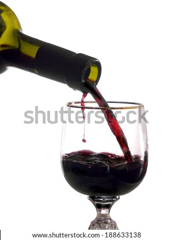 is poured into wine glass red wine, white background - stock photo
