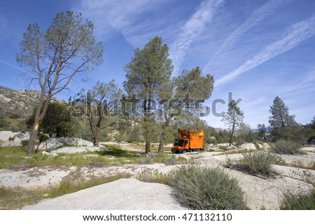 ISABELLA LAKE RECREATIONAL AREA, CALIFORNIA, USA - MARCH 14, 2016: Camping with custom orange RV truck in Alabama Hills BLM.