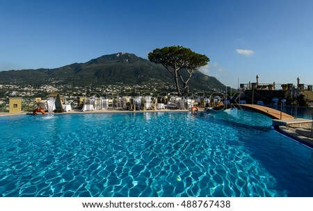 Ischia, Italy - July 28, 2014: Thermal swimming pool with mountain views of luxury hotels in San Montano.