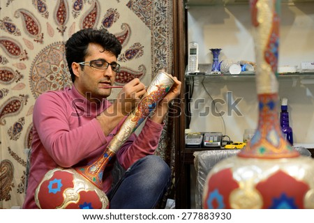 ISFAHAN - APRIL 19: Unknown man making  traditional iranian vase in market (Bazaar) in Isfahan, Iran on April 19, 2015. Bazaar of Isfahan is the most important tourist attraction in Isfahan, Iran. - stock photo