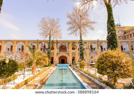 ISFAHAN, IRAN - JAN 7, 2014: Decoration of the interior yard of the Abbasi hotel built about 300 year ago in Iran, Jan 7, 2014. The 1974 movie Ten Little Indians was shot here. - stock photo
