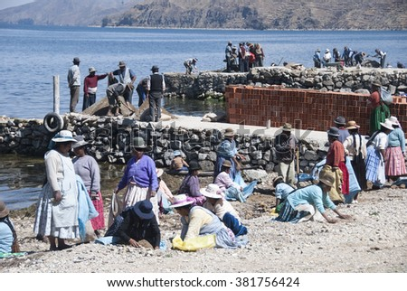 ISLA DEL SOL, BOLIVIA - NOVEMBER 2008 : The community working together for the reconstruction of the port. Isla del Sol, Bolivia . - stock photo