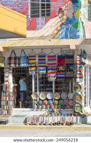 ISLA MUJERES - JANUARY 21: Side streets full of colorful souvenir shops on 21 January 2015 in Isla Mujeres, Mexico. The island is located 8 miles east of Cancun in the Gulf of Mexico.