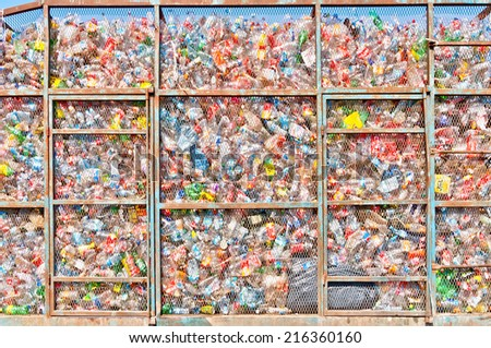 ISLA MUJERES, MEXICO - APRIL 24, 2014: collected plastic bottles lie in a heap in a metal cage in Isla Mujeres, Mexico. The plastic will be sorted for recycling. - stock photo