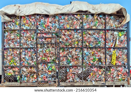 ISLA MUJERES, MEXICO - APRIL 24, 2014: plastic bottles lie in a heap in a metal cage on a truck in Isla Mujeres, Mexico. The plastic will be sorted for recycling. - stock photo