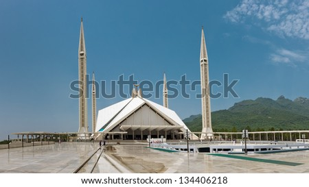 ISLAMABAD - JULY 16: Faisal Mosque on July 16, 2011 in Islamabad. It is the largest mosque in Pakistan and South Asia and named after late King Faisal of Saudi Arabia who financed the project. - stock photo