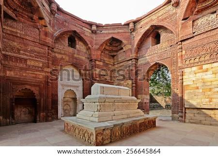 islamic grave with inscriptions at qutub minar in Delhi, India - stock photo