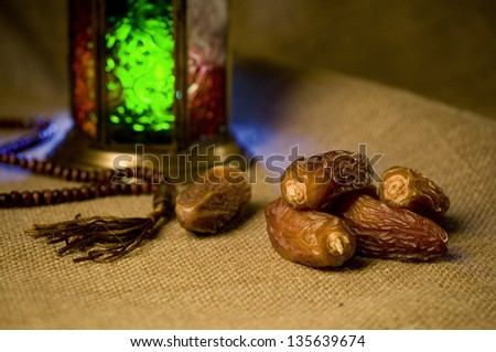 Islamic lamp and rosary - stock photo