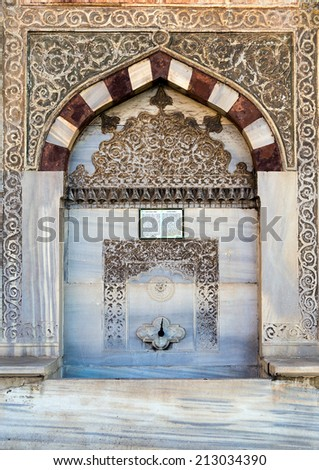 Islamic marble washstand with Koran, Istanbul, Turkey. - stock photo
