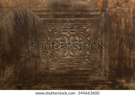 Islamic Pattern Background/wood art engraving islamic icon design in middle of wooden door in the egyptian mosque - stock photo