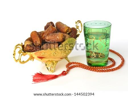 Islamic rosary and dates - stock photo
