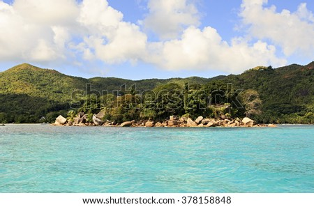 Island and hotel Chauve Souris Club in Indian Ocean - stock photo
