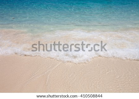 Island beach with waves in the daytime.