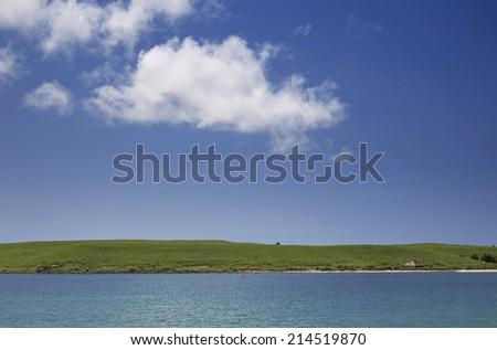 island & blue sky - stock photo