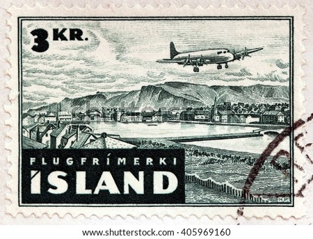 ISLAND - CIRCA 1947: A stamp printed by ISLAND shows The Esja massif seen from Reykjavik's old city center. Aircraft over Reykjavik, circa 1947 - stock photo