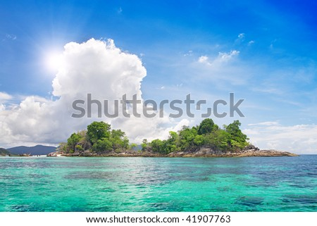 island in beautiful tropical sea - stock photo