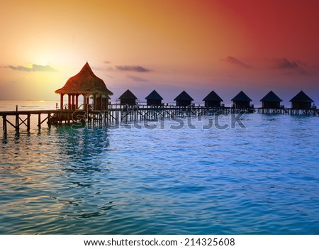 Island in ocean, Maldives.  Sunset - stock photo