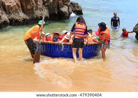 Island KyCo, Binh Dinh Province, Vietnam - August 28, 2016: Images tourists with life jackets are very excited on sailing to explore the beautiful of island KyCo, clear sea waters and long sandy beach