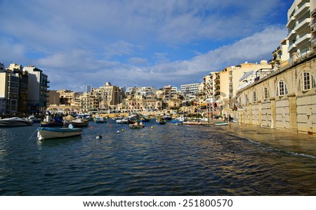 ISLAND OF MALTA,EUROPE - NOVEMBER 11, 2014. Beautiful autumn  morning at Spinola Bay, St Julian's , place full of fishing boats , awesome all seasons destination in Maltese Islands.