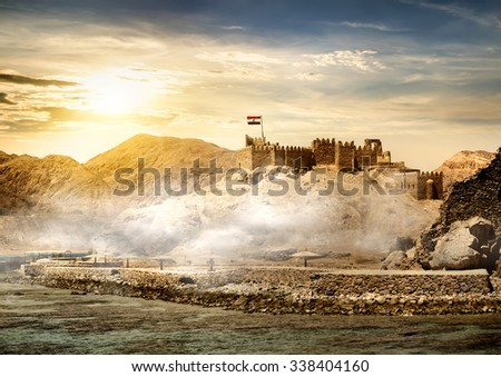 Island of pharaohs in Taba at the sunrise - stock photo