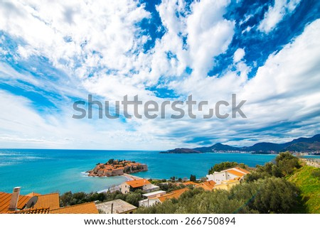 Island of Sveti Stefan in fat day - stock photo