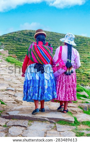 Island of the Sun, Bolivia-March 22, 2015: Bolivian  women in traditional clothes on the street .