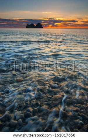 Island on background sunrise seaborne